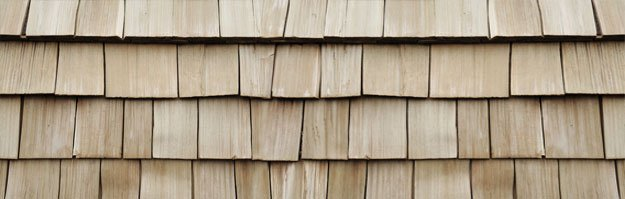 Closeup of a roof with cedar shake shingles. They can last up to 50 years.