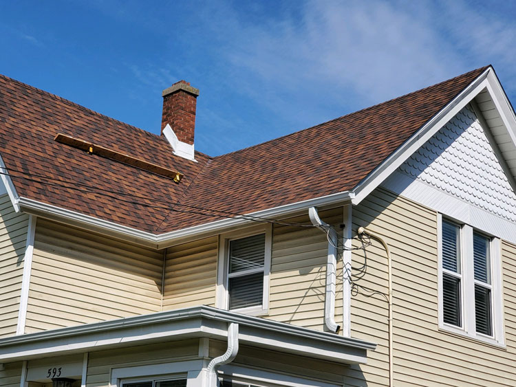 Red and Brown Shingle Roof -